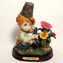 Boy potting flowers