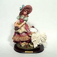 Grape girl and swan desk ornament